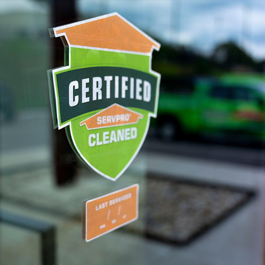 Certified: SERVPRO Cleaned window sticker with reflection